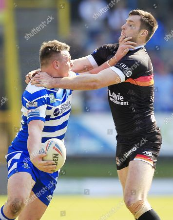 Halifax's  Ed Barber Tackled by Bradford's James Green