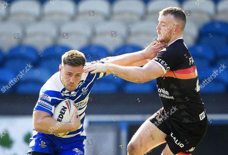Halifax's  Shaun Robinson Tackled by Bradford's Connor Farrell