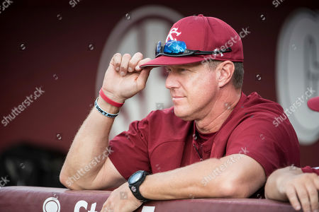 South Carolina head coach Mark Kingston watches players warm up before an NCAA college baseball game, in Columbia, S.C