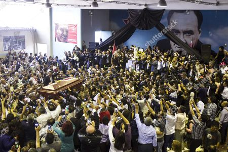 Hundreds attend the funeral of Peruvian former president Alan Garcia at the 'House of the People', headquarters of the Peruvian Aprista Party (PAP), in Lima, Peru, 19 April 2019. After the funeral, the coffin of the former president was taken through an itinerary at the historic center of Lima before arriving at the cemetery where he will be cremated in a private ceremony.