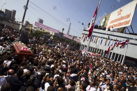 People carry the coffin of Peruvian former president Alan Garcia after the funeral at the 'House of the People', headquarters of the Peruvian Aprista Party (PAP), in Lima, Peru, 19 April 2019. After the funeral, the coffin of the former president was taken through an itinerary at the historic center of Lima before arriving at the cemetery where he will be cremated in a private ceremony.