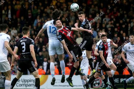Bohemians vs UCD. UCD's Richie O'Farrell with Dinny Corcoran and Conor Levingston of Bohemians
