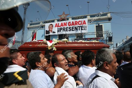 Men carry the coffin of Peru's late President Alan Garcia outside his party's headquarters where his wake was held, during his funeral procession in Lima, Peru, . Garcia shot himself in the head and died Wednesday as officers waited to arrest him in a massive graft probe that has put the country's most prominent politicians behind bars and provoked a reckoning over corruption