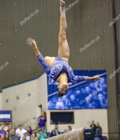 UCLA's Kyla Ross performs a tumbling pass on the balance beam during the NCAA Women's National Collegiate Gymnastics Championship Semi-Final 1 at the Fort Worth Convention Center in Fort Worth, TX