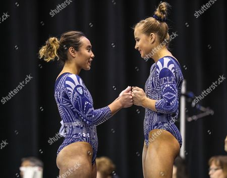 Stock Image of UCLA's Katelyn Ohashi and and Madison Kocian support each other during the beam rotation at the NCAA Women's National Collegiate Gymnastics Championship Semi-Final 1 at the Fort Worth Convention Center in Fort Worth, TX