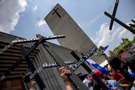 People protest against Daniel Ortega's Government during the procession of the Way of the Cross, in Managua, Nicaragua, 19 April 2019.