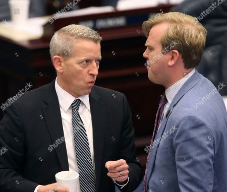 Paul Renner, James Grant. Rep. Paul Renner, R-Palm Coast, left, confers with Rep. James Grant, R-Tampa, during session, in Tallahassee, Fla