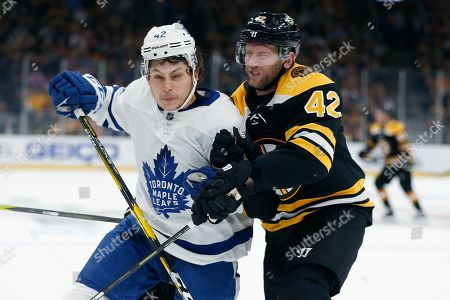 Trevor Moore, David Backes. Boston Bruins' David Backes, right, and Toronto Maple Leafs' Trevor Moore compete for the puck during the second period in Game 5 of an NHL hockey first-round playoff series in Boston