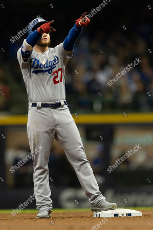Los Angeles Dodgers center fielder Alex Verdugo #27 doubles to left center field scoring Cody Bellinger #35 in the second inning of the Major League Baseball game between the Milwaukee Brewers and the Los Angeles Dodgers at Miller Park in Milwaukee, WI