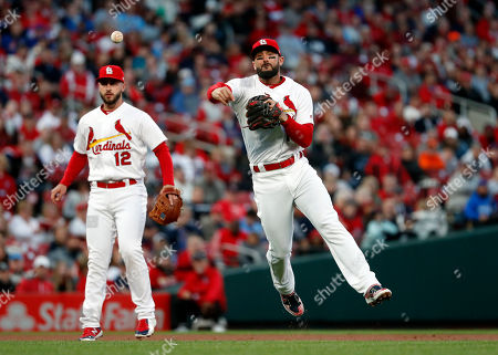 St. Louis Cardinals third baseman Matt Carpenter throws to first as shortstop Paul DeJong (12) watches during the first inning of a baseball game against the New York Mets, in St. Louis