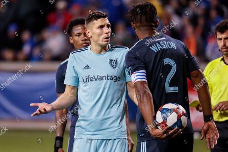 Damir Kreilach, Kendall Waston. Real Salt Lake midfielder Damir Kreilach, center left, reacts toward FC Cincinnati defender Kendall Waston (2) during the second half of an MLS soccer match, in Cincinnati