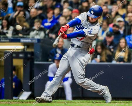 Los Angeles Dodgers right fielder Alex Verdugo hits an RBI double to drive in Los Angeles Dodgers first baseman Cody Bellinger in the second inning of the MLB game between the Los Angeles Dodgers and the Milwaukee Brewers at Miller Park in Milwaukee, Wisconsin, USA, 19 April 2019.