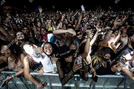 Stock Image of The public reacts in the pit as DJ Snake during the Coachella Valley Music and Arts Festival in Indio near Palm Springs, California, USA, 19 April 2019 (issued 20 April 2019). The festival runs from 12 to 21 April 2019.