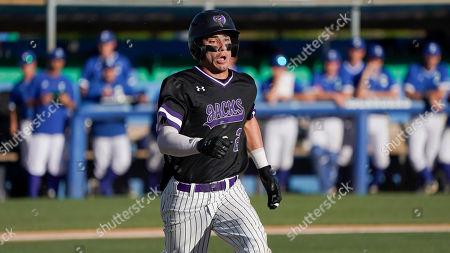 Stock Photo of Stephen F. Austin's Nick Daley runs during an NCAA college baseball game against Texas A&M-Corpus Christi, in Corpus Christi, Texas