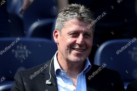 Stock Image of TV pundit Andy Townsend in the stands