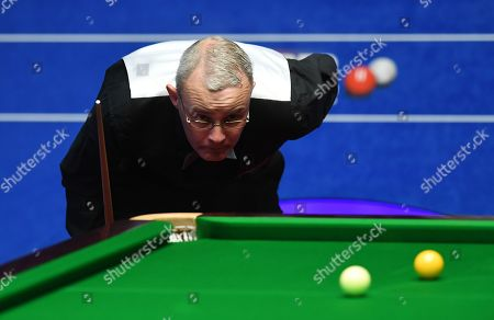 Martin Gould of England at the table during his first round match