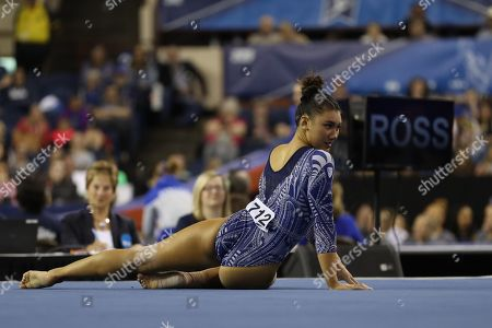 UCLA gymnast Kyla Ross competes during the NCAA Women's Gymnastics Championships Semi-Final 1 at the Fort Worth Convention Center in Fort Worth, TX. Melissa J