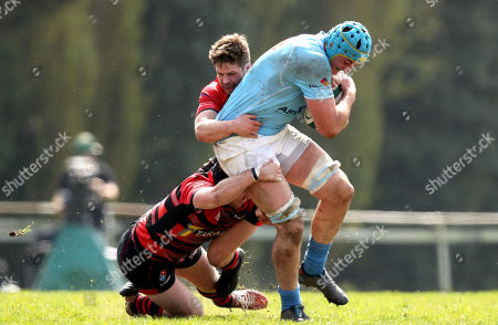 City of Armagh vs Garryowen. Garryowen's Kevin Seymour is tackled by Andrew Smyth and Chris Colvin of City of Armagh