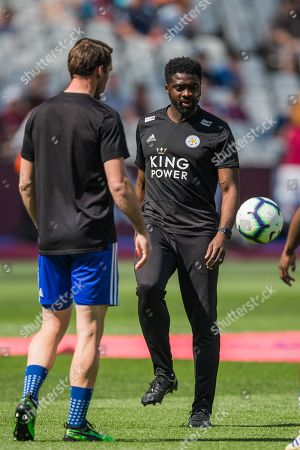 Kolo Toure, First Team Coach for Leicester City FC with the team warming up ahead of the Premier League match between West Ham United and Leicester City at the London Stadium, London
