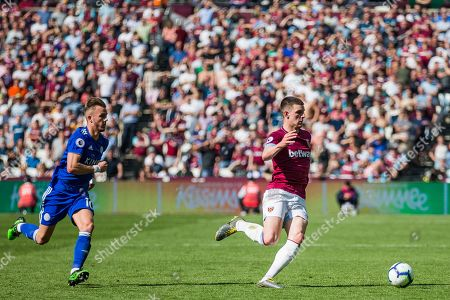 James Maddison (Leicester City) & Declan Rice (West Ham) during the Premier League match between West Ham United and Leicester City at the London Stadium, London