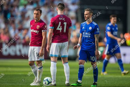 Mark Noble (Capt) (West Ham), Declan Rice (West Ham) and James Maddison (Leicester City) during the Premier League match between West Ham United and Leicester City at the London Stadium, London
