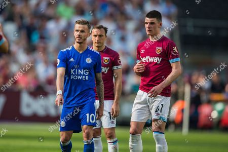 James Maddison (Leicester City) with Declan Rice (West Ham) & Mark Noble (Capt) (West Ham) looking on during the Premier League match between West Ham United and Leicester City at the London Stadium, London
