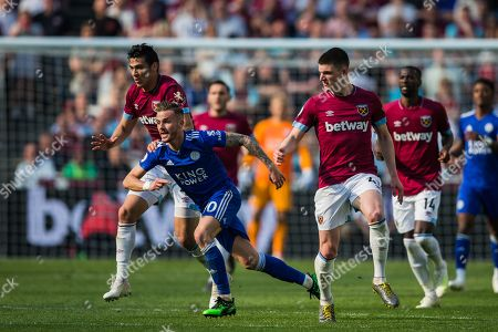 James Maddison (Leicester City) races past Declan Rice (West Ham) during the Premier League match between West Ham United and Leicester City at the London Stadium, London