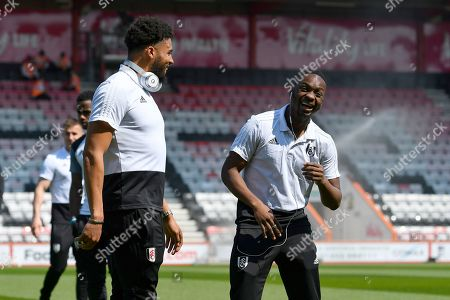 Timothy Fosu-Mensah (21) of Fulham and Jean Michael Seri (24) of Fulham share a joke on arrival before the Premier League match between Bournemouth and Fulham at the Vitality Stadium, Bournemouth