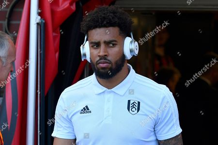 Timothy Fosu-Mensah (21) of Fulham with headphones on as he walks out of the tunnel on arrival before the Premier League match between Bournemouth and Fulham at the Vitality Stadium, Bournemouth