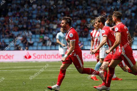 Girona's players Cristian Portugues (L), Pere Pons (C) and Uruguayan Cristhian Stuani (R) celebrate a goal during the Primera Division Liga match between Celta de Vigo and Girona FC held at Balaidos stadium in Vigo, Spain, 20 April 2019.