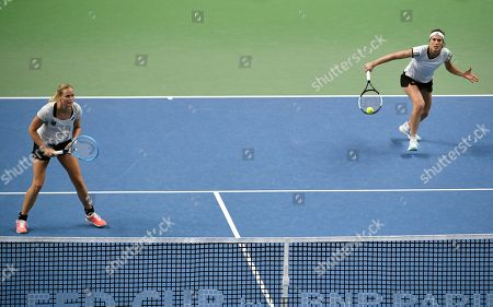Anna-Lena Groenefeld Andrea Petkovic. Germany's Anna-Lena Groenefeld, left, and Andrea Petkovic in action during their play-off round Fed Cup doubles tennis match against Latvia's Jelena Ostapenko un Daniela Vismane in Riga, Latvia