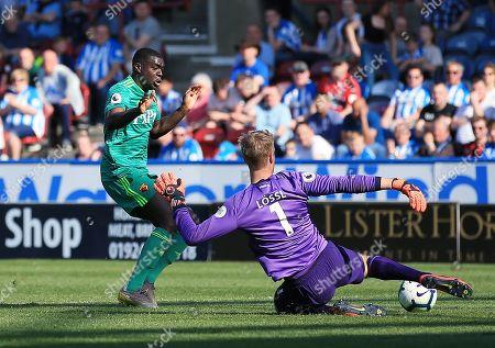 Stock Image of Ken Sema of Watford and Huddersfield Town goalkeeper Jonas Lossl