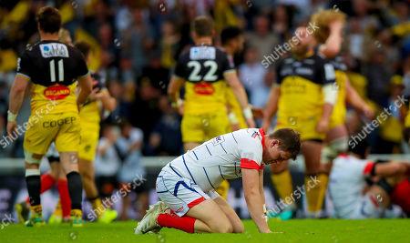 La Rochelle vs Sale Sharks. Sale Sharks' Sam James dejected at the final whistle