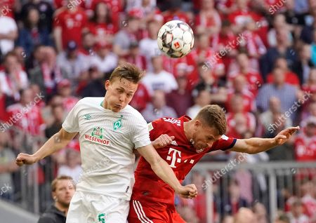 Bayern's Joshua Kimmich (R) in action against Bremen's Ludwig Augustinsson (L) during the German Bundesliga soccer match between FC Bayern Munich and Werder Bremen in Munich, Germany, 20 April 2019.