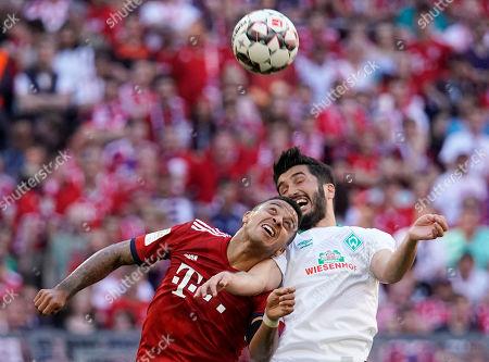 Bayern's Thiago (L) in action against Bremen's Nuri Sahin (R) during the German Bundesliga soccer match between FC Bayern Munich and Werder Bremen in Munich, Germany, 20 April 2019.