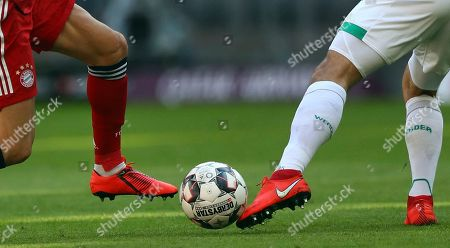 Bayern forward Robert Lewandowski, left, fights for the ball with Bremen's defender Ludwig Augustinsson during the German Bundesliga soccer match between Bayern Munich and Werder Bremen at the Allianz Arena in Munich, Germany