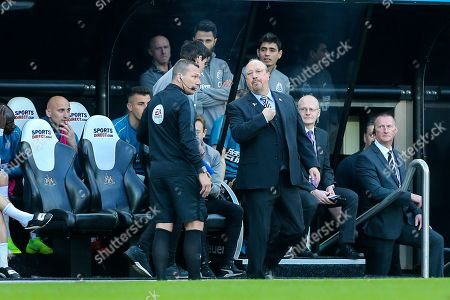 Newcastle United manager Rafael Benitez in discussion with fourth official Kevin Friend as Newcastle United first team coach Mikel Antia is sent to the stand during the Premier League match between Newcastle United and Southampton at St. James's Park, Newcastle