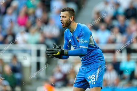 Angus Gunn (#28) of Southampton offers encouragement to his team mates at a corner during the Premier League match between Newcastle United and Southampton at St. James's Park, Newcastle