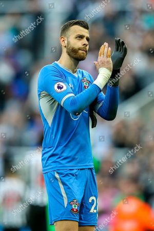 Angus Gunn (#28) of Southampton applauds the Southampton supporters following the Premier League match between Newcastle United and Southampton at St. James's Park, Newcastle