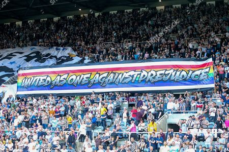 Newcastle United fans display a banner reading 'United as one against prejudice' ahead of the Premier League match between Newcastle United and Southampton at St. James's Park, Newcastle