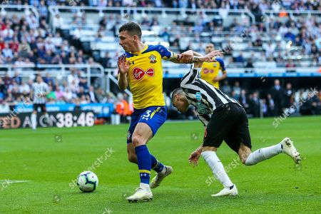 Pierre-Emile Hojbjerg (#23) of Southampton challenges Miguel Almiron (#24) of Newcastle United during the Premier League match between Newcastle United and Southampton at St. James's Park, Newcastle