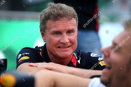 Former British Formula One driver David Coulthard (L) talks to Dutch DJ Armin van Buuren (R) before an event in Hanoi, Vietnam, 20 April 2019. The Formula One Vietnam Grand Prix kick-off event which featured live performance of David Coulthard at My Dinh stadium has attracted thousands of people and fans. Vietnam will be the 22nd country in the world to be hosting a Formula One Grand Prix.