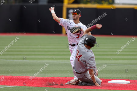 Northeastern's Jake Rosen (3) turns the double play as Charleston's Logan McRae (34) runs to second base during an NCAA college baseball game, in Brookline, Mass