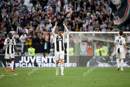 From left, Juventus' Blaise Matuidi, Cristiano Ronaldo and Daniele Rugani celebrate at the end of a Serie A soccer match between Juventus and AC Fiorentina, at the Allianz stadium in Turin, Italy, . Juventus clinched a record-extending eighth successive Serie A title, with five matches to spare, after it defeated Fiorentina 2-1