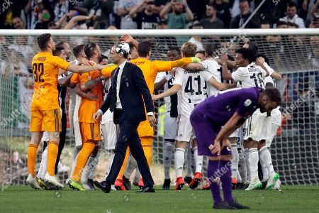 Juventus players celebrate at the end of a Serie A soccer match between Juventus and AC Fiorentina, at the Allianz stadium in Turin, Italy, . Juventus clinched a record-extending eighth successive Serie A title, with five matches to spare, after it defeated Fiorentina 2-1