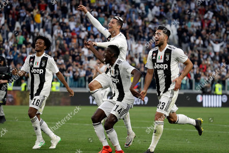 From left, Juventus' Juan Cuadrado, Cristiano Ronaldo, Blaise Matuidi and Emre Can celebrate at the end of a Serie A soccer match between Juventus and AC Fiorentina, at the Allianz stadium in Turin, Italy, . Juventus clinched a record-extending eighth successive Serie A title, with five matches to spare, after it defeated Fiorentina 2-1