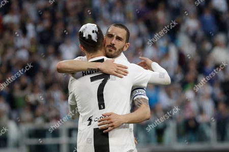 Juventus' Cristiano Ronaldo celebrates with his teammate Leonardo Bonucci at the end of a Serie A soccer match between Juventus and AC Fiorentina, at the Allianz stadium in Turin, Italy, . Juventus clinched a record-extending eighth successive Serie A title, with five matches to spare, after it defeated Fiorentina 2-1