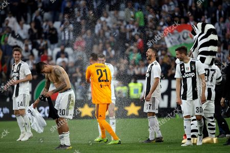 Stock Photo of Juventus players celebrate at the end of a Serie A soccer match between Juventus and AC Fiorentina, at the Allianz stadium in Turin, Italy, . Juventus clinched a record-extending eighth successive Serie A title, with five matches to spare, after it defeated Fiorentina 2-1