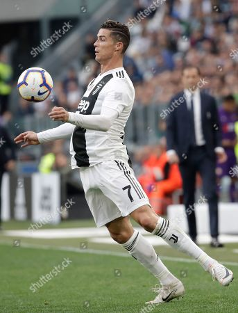 Juventus' Cristiano Ronaldo controls the ball during a Serie A soccer match between Juventus and AC Fiorentina, at the Allianz stadium in Turin, Italy, . Juventus needs a draw against visiting Fiorentina to clinch a record-extending eighth straight Serie A title
