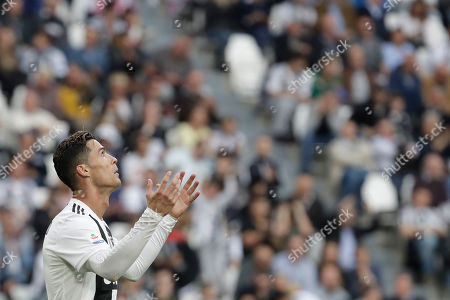 Juventus' Cristiano Ronaldo reacts during a Serie A soccer match between Juventus and AC Fiorentina, at the Allianz stadium in Turin, Italy, . Juventus needs a draw against visiting Fiorentina to clinch a record-extending eighth straight Serie A title